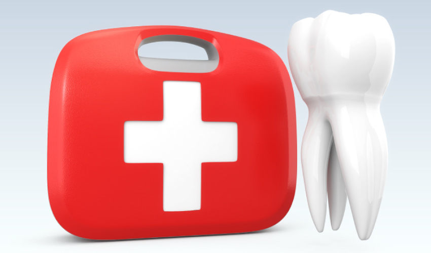 A red first aid kit next to a tooth